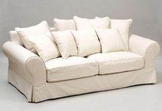 Cuándo tapizar un sofá y saber si merece la pena: Sofa con almohadones, son más caros de retapizar.