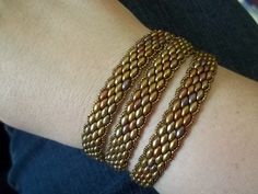 Kelly from Off the Beaded Path, in Forest City, North Carolina shows you how to make a Super Duo Peyote Stitch Wrap Bracelet. We have materials used to make ...