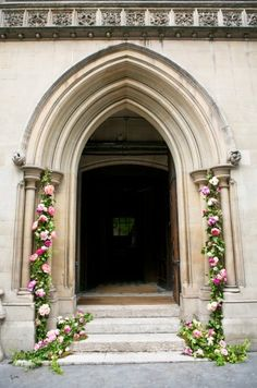 Floral and greenery garlands on cathedral door | photography by http://oneandonlyparisphotography.com/blog/ and http://www.lesecretdaudrey.com/