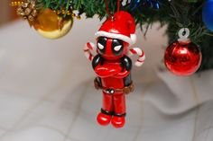 I finally finished my biggest order yet. A good friend of mine ordered a whole bunch of Christmas ornaments, each tailored to a friend or family member. It was a challenge, but a fun one! Diy Halloween Decorations, Christmas Decorations, Holiday Decor, Winter Holiday, Holiday Crafts, Deadpool Christmas, Biscuit, Beaded Banners, Geek Crafts