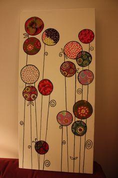 Un bien joli tableau fait avec des restes de papiers cadeaux.des restes de papiers cadeaux
