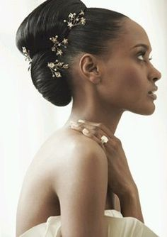 African-american wedding hair updo with beautiful hair accessories for bling.