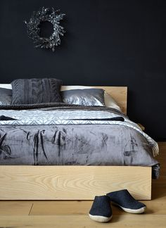 The Kulu bed with bedding, cushions and slippers - from Natural Bed Company.