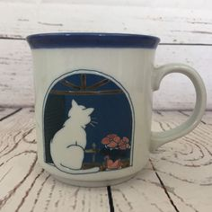 "Condition: Gently used condition; no chips or cracks; some wear to bottom of mug as seen in photo. Measurements: 3 3/4"" Tall x 3 1/4"" in Diameter. 