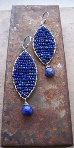 Sterling silver marquise shaped frames are hammered and oxidized then woven with AAA+ quality lapis lazuli rondells. The color is incredible!
