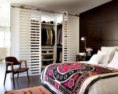 Cool closet idea- creates more open space without the clutter for a small master