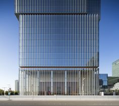 Architecture facade Gallery of Al Hilal Bank Office Tower / Goettsch Partners - 9 Al Hilal Bank Office Tower,© Tom Rossiter Office Building Architecture, Facade Architecture, Office Buildings, B720, Banks Office, Glass Curtain Wall, Office Entrance, Box Building, Glass Office