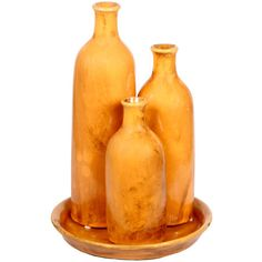 Set of three ceramic vases with a coordinating tray.    Product: Small, medium and large vase with plate    Construction M...