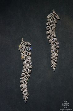 CARTIER Two so-called fern spray brooches, 1903, platinum, diamond