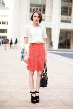 pleated printed skirt and detailed white blouse