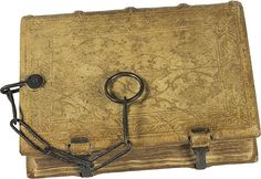 Theological Miscellany, Germany, late 15th century.   This book provides a rare example of an original 15th century binding. It is made up of wooden boards covered with tooled pigskin, with a chain attached to the back cover. The chain indicates that the book was once owned by an institutional library, which stored this book attached to a shelf. Codex manuscripts were expensive and scarce, and libraries took measures to protect them from theft or loss.
