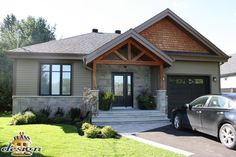 Complete exterior renovation from boring ranch style to a for Foyer brique exterieur