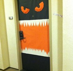 Halloween Monster Door Decoration My roommates and I did this to our dorm front door our first year!  We basically just used butcher paper, paper plates, glue, and scissors.  Super easy and fun!