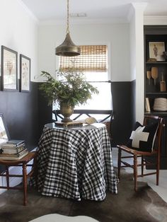 Dramatic wall colors in a small nook distinguish it from the larger space. We love the contrast of black and white walls in this One Room Challenge from Design Indulgence.