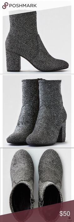 AEO Woman's Sock Bootie Silver/Black New in Box The every season essential. Stay cool and grounded in bottom's up style that's as unique as you. Shine on with glitter finish Heeled Padded insole Rubber outsole   98.4% Textile, 1.6% Metal Imported Sizes 7 & 8 AEO Shoes Ankle Boots & Booties
