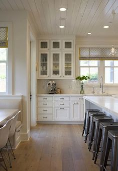 Image result for distressed white shaker cabinets plank floors glass subway tile