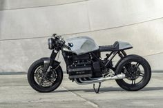 Is the BMW due for a turn in the custom limelight? We reckon so. This cafe racer from LA has a brutal beauty you don't often see. Bmw Cafe Racer, Cafe Racers, Cafe Racer Build, R65, K100, Bmw Scrambler, Scrambler Custom, Bike Bmw, Moto Bike