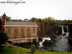 The Great Falls of Paterson, which stand 77 feet tall. The hydroelectric plant to the left was constructed in 1914 and provided hydroelectric power until 1969. The building was restored in 1982 and provides power to Paterson today. Discover more history at www.thehistorygirl.com