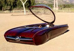 Originally belonged to George Jetson, then his son Elroy who lowered it and painted it this cool maroon color!