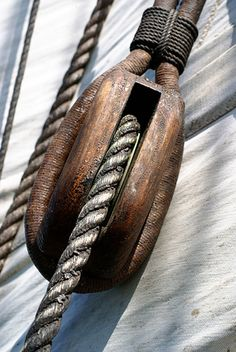 blackheartedbrigand:  Enterprize Tall Ship by carolleeg on Flickr.  Nice lookin' block an' tackle! Every Capn' should every last bit o' their ship!