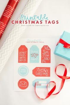 Printable Gift Tags for Christmas from @kristenduke - Simply download, print, and cut. These hand lettered tags will add an extra ounce of holiday cheer to all your gifts this year.