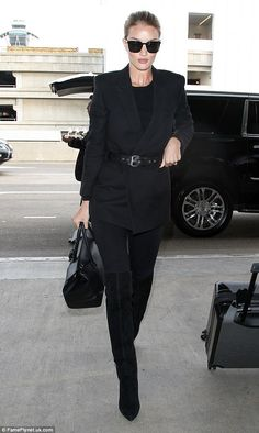 Runway ready! Rosie Huntington-Whiteley showed her gym efforts were certainly paying off when she jetted out of LAX on Friday