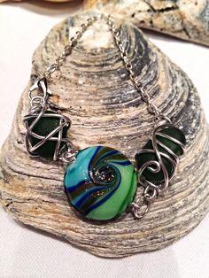 £7.99Unique dark green sea glass silver plated bracelet