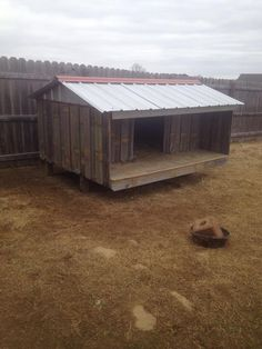Our goat house. Made in a weekend using an old fence we tore down and two metal sheets.