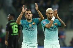 Barcelona's Brazilian forward Neymar (R) and Barcelona's defender Jordi Alba applaud after the UEFA Champions League first-leg group C football match between Borussia Moenchengladbach and FC Barcelona at the Borussia Park in Moenchengladbach, western Germany on September 28, 2016. / AFP / Odd ANDERSEN