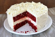 Red Velvet Cheesecake Cake -- Just like The Cheesecake Factory's version… a red velvet layer-cake with a layers of cheesecake mixed in… topped with cream cheese icing.
