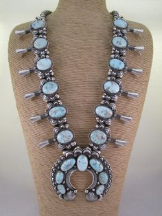 This stunning Dry Creek Turquoise Squash Blossom Necklacewas made by Navajo jewelry artist / silversmith, Delbert Gordon. Traditional, Large,and Lovely!