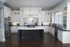 black island with white marble top; black granite or soapstone counters