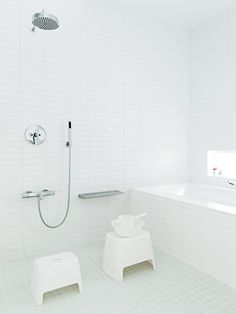Japanese style bathroom - soaking bath and eye level shower and faucet