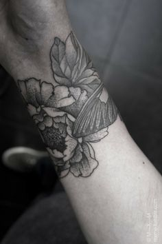 flower wrist cuff tattoo. i'd get it on my upper arm