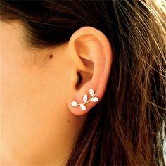 https://www.cityblis.com/4497/item/15377  Drop Ear Cuff - $28 by Amorium  Cubic zirconia crystals in drop form in an ear cuff