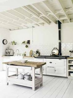 love the subway tiles and the aga stove and the painted wood floor and the exposed beams and the island and basically omg I love this kitchen! Aga Kitchen, Unfitted Kitchen, Cocinas Kitchen, Country Kitchen, Nice Kitchen, Awesome Kitchen, Home Decor Kitchen, Kitchen Design, Aga Stove