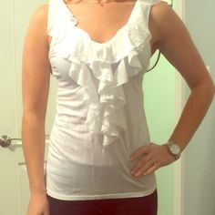 White ruffle express top! White top with a ruffle down the center. Great detail and easy to wear! Express Tops Tank Tops