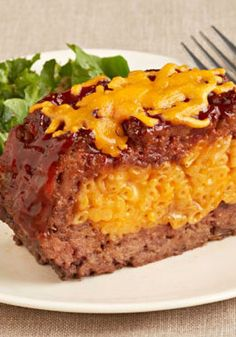 Macaroni and Cheese Stuffed Meatloaf – Tender, juicy meatloaf stuffed with classic KRAFT Macaroni & Cheese? Oh, yes—and making it is even easier than it might sound. Your kids are sure to really enjoy the cheesy surprise inside! Meat Recipes, Cooker Recipes, Recipies, Meatloaf Recipe With Cheese, Stuffed Meatloaf Recipes, Stuffed Burgers, Macaroni Cheese, Mac Cheese, Cheese Burger