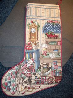 Christmas cross stitch stocking by LeopardLadyJewels on Etsy, $140.00.   I wish I had the time to do this myself. Reminds me of my Auntie Faye. She made beautiful cross stitch stockings!