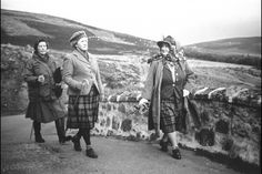 The Queen Mother walking with friends in Balmoral, Scotland in 1963.
