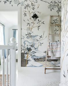 If a handpainted treatment isn�t in your budget, a floral wallpaper and outdoorsy rummage sale ladder may be. Photographer: Andr� Rider Designer: Les Ensembliers