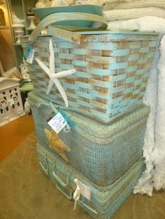 The middle basket in this stack had been in my booth at Stars for some time. It was time to bring it home for a make over. Since the sea grass trunk on the bottom had sold so quickly, I decided t...