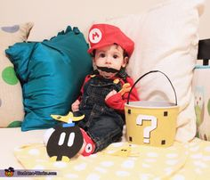 Super Mario DIY Baby Costume, the materials used were felt and foam. The hat was hand stitched using felt and a foam m Logo. The bucket was covered in felt...