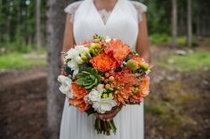 A fun but elegant bright orange, green and white wedding bouquet with flowers and succulents. Photo by one-edition.ca