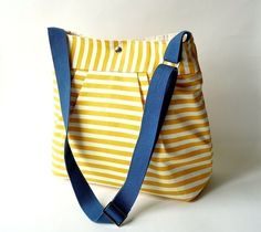 The Stockholm by etsy seller ikabags.  Also available with a cream-colored strap.  Gorgeous!  It makes me want to wear a Vera Neumann scarf in my hair :).