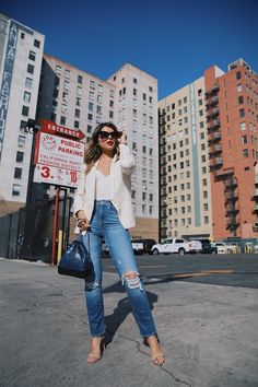 Pam Hetlinger wearing a mother denim jeans with a capulet bodysuit, chanel gabrielle bag and armani lip maestro lipstick
