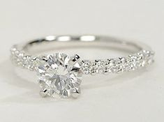Exquisite in design, this diamond engagement ring features a delicate row of U-prong set diamonds to beautifully frame your center diamond. Setting includes 1/3 carat total diamond weight.