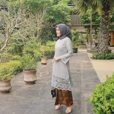 Image may contain: one or more people, tree and outdoor Kebaya Lace, Batik Kebaya, Kebaya Dress, Batik Dress, Model Kebaya Brokat Modern, Kebaya Modern Hijab, Kebaya Hijab, Model Kebaya Muslim, Dress Brukat