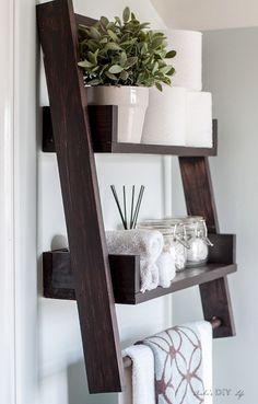 This is the perfect twist to the floating shelf and the ladder shelf! DIY floating ladder shelf with a towel bar! This is the perfect twist to the floating shelf and the ladder shelf! DIY floating ladder shelf with a towel bar! Floating Shelves Bathroom, Floating Wall, Bathroom Ladder Shelf, Bathroom Shelves Over Toilet, Shelf Wall, Above The Toilet Storage, Ladder Shelf Decor, Over The Toilet Ladder, Bathroom Towel Storage