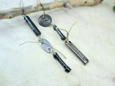 asymmetrical earrings with a resistor and capacitors by boele